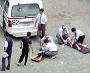 SCHOOL CHILDREN LAY ON STRETCHERS